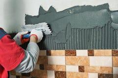 Laying Ceramic Tiles. Stock Images