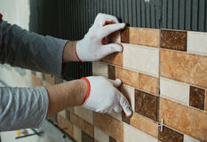 Laying Ceramic Tiles. Royalty Free Stock Image