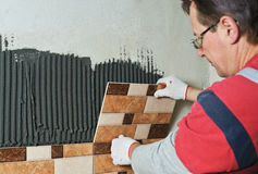 Laying Ceramic Tiles. Stock Photography