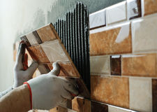 Laying Ceramic Tiles. Stock Photos