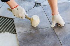 Laying Ceramic Tiles. Royalty Free Stock Photos