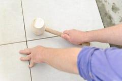 Laying Ceramic Tiles Royalty Free Stock Images