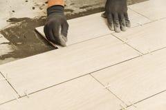 Laying Ceramic Tiles Royalty Free Stock Image
