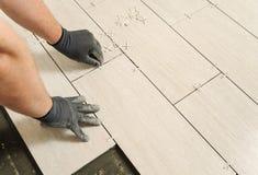 Laying Ceramic Tiles Stock Photos