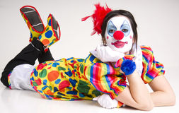 Laying down female circus clown polkadot outfit Stock Photos