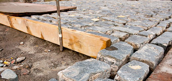 Laying cobblestone path Royalty Free Stock Image