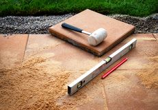 Laying concrete paving in the lawn stock photography
