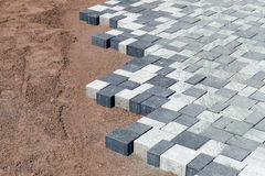Laying concrete paving Stock Images