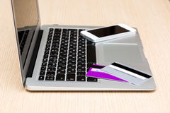 Laying credit cards and phone on a laptop. View of laptop with credit cards and phone Stock Image