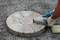 Laying decorative pavers Royalty Free Stock Photo