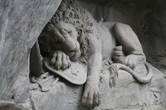 Laying down Lion statue Monument at Lucerne, Switzerland, attractive sculpture landmark Royalty Free Stock Image