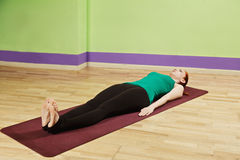 Laying down on mat pose Royalty Free Stock Photos