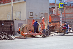 Laying of an electric cable under asphalt municipal services. Samara Royalty Free Stock Image