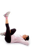 Laying exercising woman on white background Royalty Free Stock Images