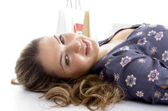 Laying female with bags Royalty Free Stock Image