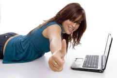 Laying female with notebook and wishing good luck Royalty Free Stock Photography