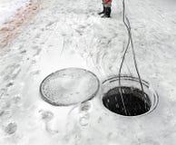 Laying of fiber optic cable through underground communications i Stock Photo