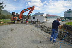 Laying fibre optic cable. GREYMOUTH, NEW ZEALAND, APRIL 1, 2014: Workers lay a fibre optic cable as part of a government scheme to bring high-speed internet Royalty Free Stock Images