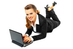 Laying on floor business woman using laptop Royalty Free Stock Photo