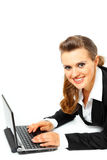 Laying on floor business woman using laptop Stock Photo