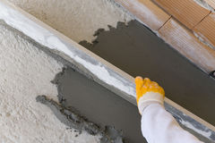 Laying of floor coating. During construction by an experienced craftsman stock photo