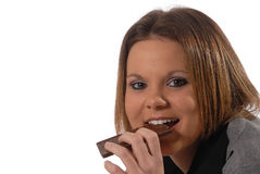 Laying on floor eating a chocolate bar. Laying on floor eating a chocolate candy bar Royalty Free Stock Photography