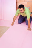 Laying floor insulation in a new house Royalty Free Stock Photo