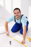 Laying the flooring at home. The isolation foam layer Stock Photos