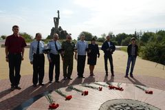 Laying flowers at the memorial  Zmievskaya Balka  - in memory of the victims of Nazism Stock Images