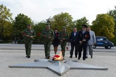 Laying flowers to the eternal flame at the memorial to the Defenders of the Motherland in Kamensk-Shakhtinsky Royalty Free Stock Images