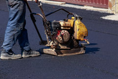 Laying fresh asphalt Stock Images