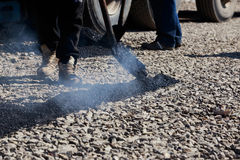 Laying fresh asphalt Stock Photos
