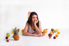 Laying between the fruits Royalty Free Stock Photo