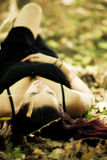 Laying girl on the forest Royalty Free Stock Image
