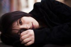 Laying girl portrait Stock Photos
