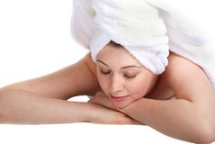 Laying girl in towel. Pretty girl laying down, hair wrapped in a towel. Spa theme Royalty Free Stock Images