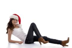 Laying glamorous woman with christmas hat. On an isolated background Royalty Free Stock Photography