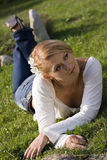Laying on the grass Stock Images