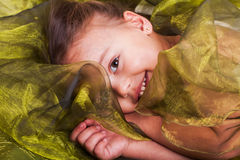 Laying in the green organza Royalty Free Stock Image