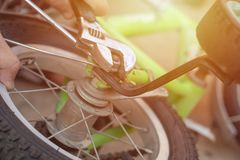 Laying on the ground kids bicycle. Close-up photo stock images