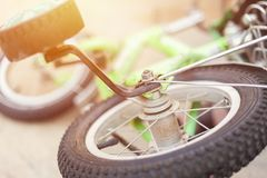Laying on the ground kids bicycle. Close-up photo royalty free stock photos