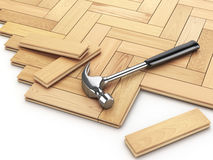 Laying hardwood parquet concept. Hammer on the floor. Royalty Free Stock Photos