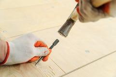 Laying hardwood parquet. Stock Image