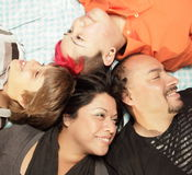 Laying with heads together Royalty Free Stock Photo