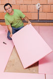 Laying insulation layer in a new house Stock Photography