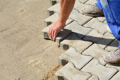 Laying interlocking pavers Royalty Free Stock Photo
