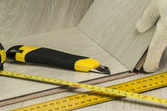 Laying laminate in the apartment Royalty Free Stock Photo