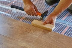 Free Laying Laminate Covering On Heat-insulated Floor Stock Images - 147541204