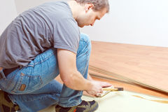 Laying laminate floor Stock Photos