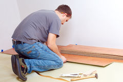 Laying laminate floor Stock Photography